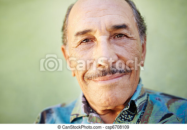 aged latino man smiling at camera - csp6708109