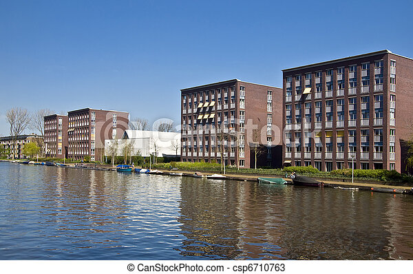 Modern architecture in Amsterdam. Modern houses in the new district of Amsterdam in the channel.