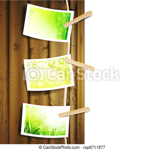 green foliage photos pinned to a rope - csp6711877