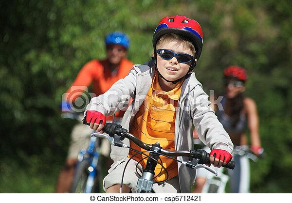 Boy riding bicycle - csp6712421