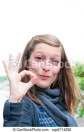 woman outdoors portrait with OK - csp6714292