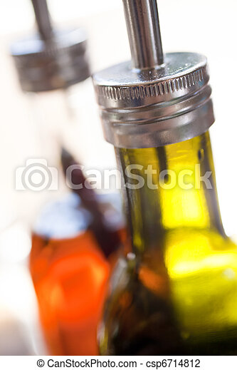 Bottles of Olive Oil and Chili Oil in Restaurant - csp6714812