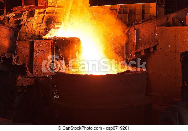Pouring of liquid metal in open hearth workshop - csp6719201