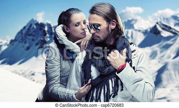 Handsome couple having fun on winter holidays - csp6720683