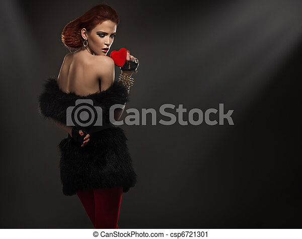 Beauty lady in fur holding red heart - csp6721301