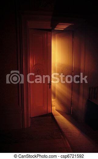 Heavenly rays of light behind the door - csp6721592