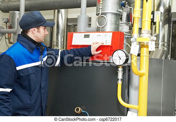 heating engineer repairman in boiler room - csp6722017