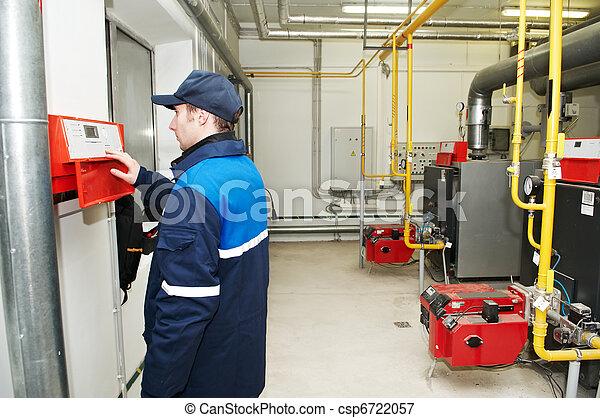 heating engineer repairman in boiler room - csp6722057