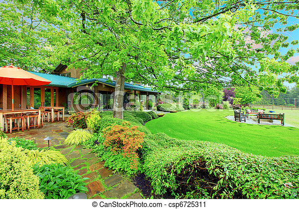Horse farm house back yard with covered deck - csp6725311