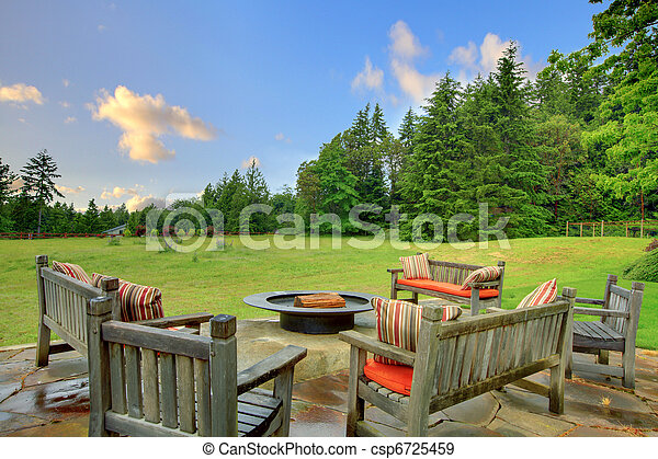 Sitting benches and fire pit and green nature - csp6725459