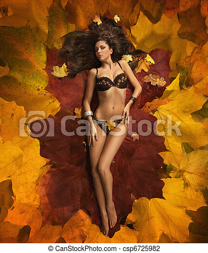 Cute woman laying on the leaves - csp6725982