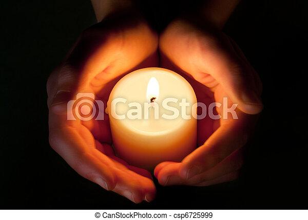candle between the hands - csp6725999