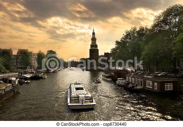 Amsterdam cityscape at evening. - csp6730440