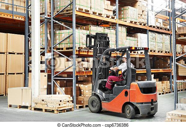 worker driver at warehouse forklift loader works - csp6736386