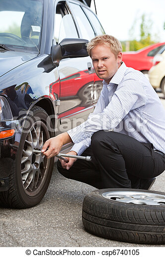 Business Man Replacing Tire - csp6740105