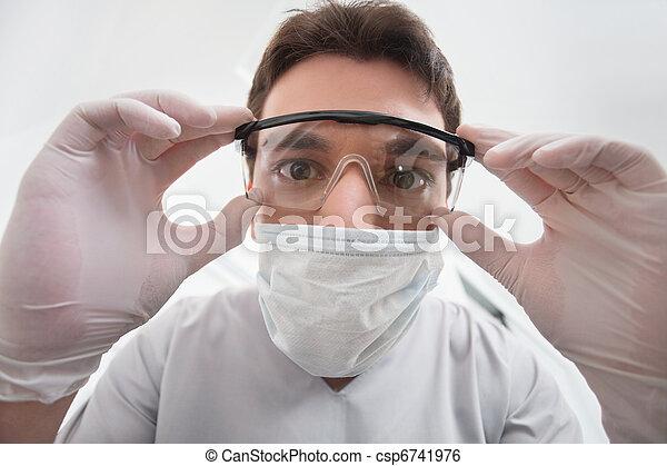 Dentist adjusting eyewear - csp6741976