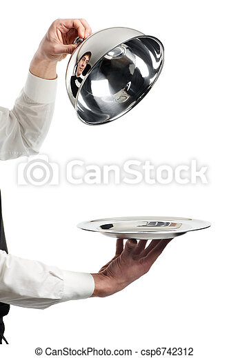 hands of waiter with cloche lid cover - csp6742312