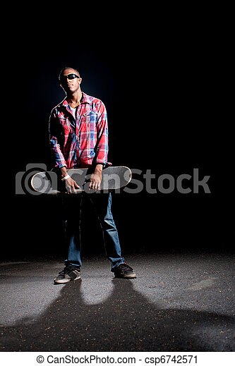 Cool Skateboarder Dude Posing - csp6742571