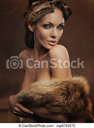 portrait of a beautiful woman wearing fur - csp6743572