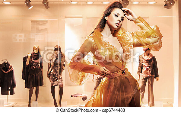 Sexy woman in front of a window shop - csp6744483