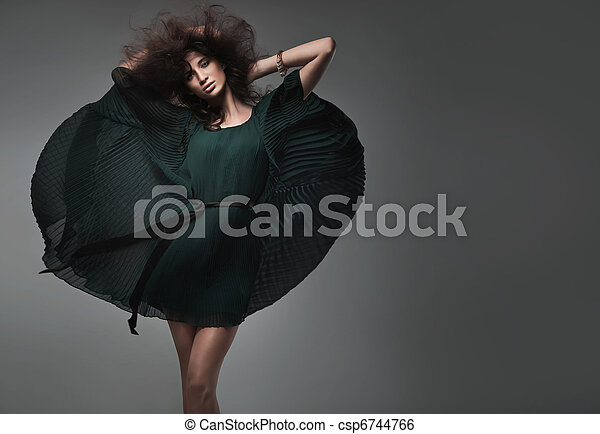 Vogue style studio shot of a young woman - csp6744766
