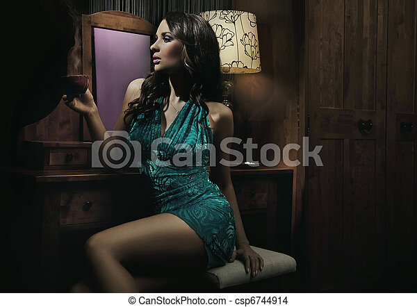 Amazing young beauty in pretty dres drinking coffe and relaxing - csp6744914