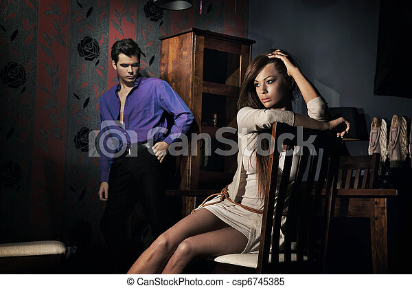 Photo of amazing young couple in nice room - csp6745385