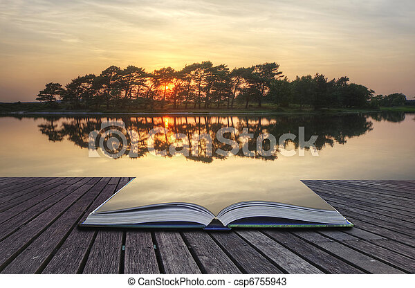 Creative concept image of reflected sunset lake coming out of pages in magical book - csp6755943
