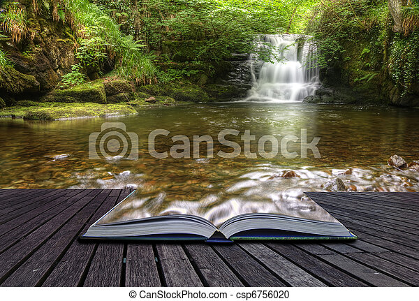 Creative concept image of flowing forest waterfall coming out of pages in magical book - csp6756020