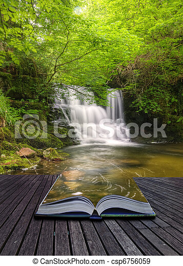 Creative concept image of flowing forest waterfall coming out of pages in magical book - csp6756059