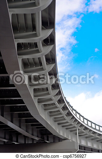 automobile overpass on background of blue sky with clouds. bottom view - csp6756927