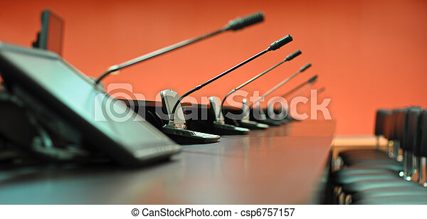 Conference table, microphones and office chairs close-up - csp6757157