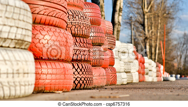racetrack fence of white and red of old tires - csp6757316