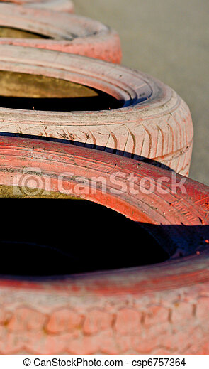 close up of racetrack fence of  red  old tires - csp6757364