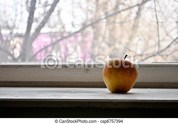 Red apple on a window sill - csp6757394