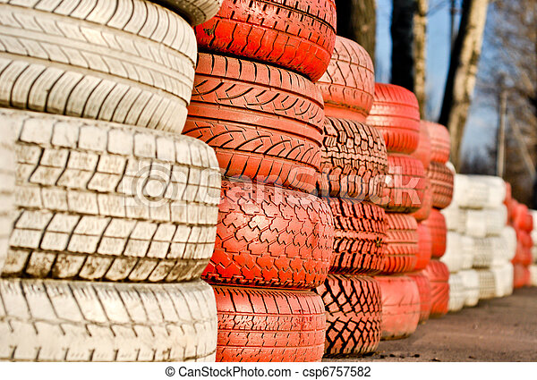 racetrack fence of white and red of old tires - csp6757582