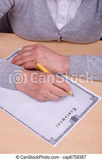 elderly woman writing testament - csp6759387
