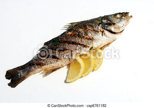 grill cooked fish with lemon slices on white background - csp6761182