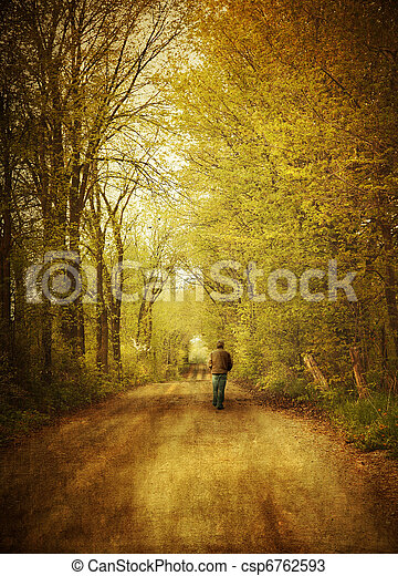 Man walking  on a lonely country road - csp6762593