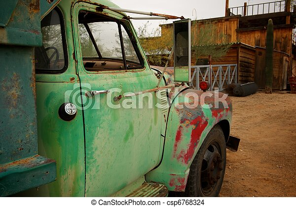 Rusty Old Truck with patches of green and red paint - csp6768324