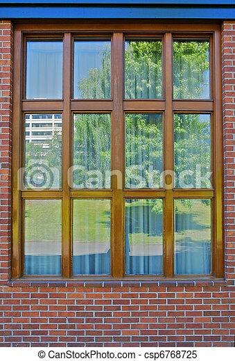 Wood bordered window reflection - csp6768725