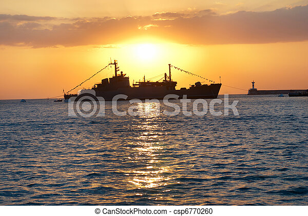 Military ship against sunset - csp6770260