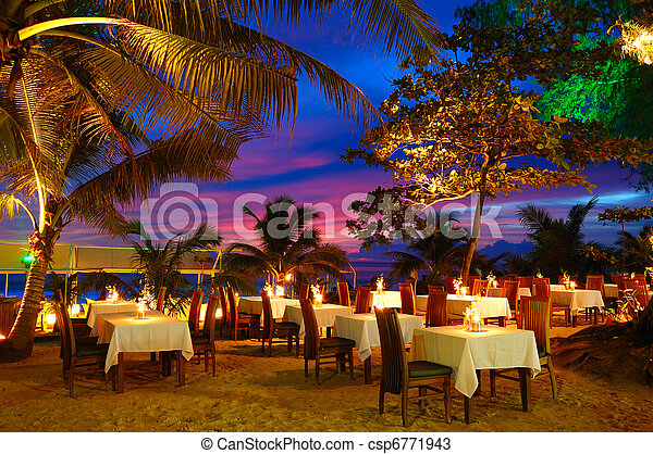 Outdoor restaurant at the beach during sunset, Phuket, Thailand - csp6771943