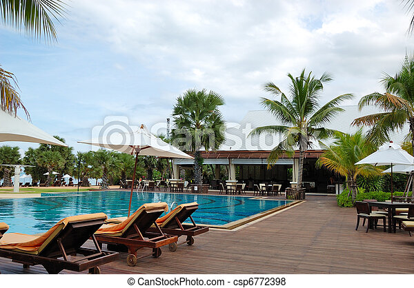 Swimming pool at the beach and bar of the popular hotel, Pattaya, Thailand - csp6772398