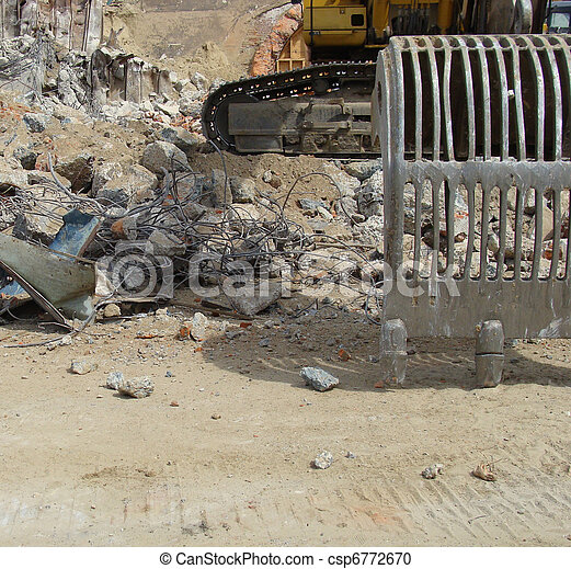excavator and demolition rubble on an industrial construction site - csp6772670