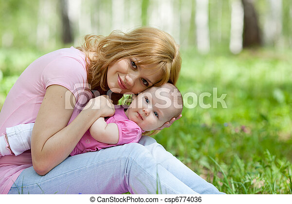 Mother and daughter in birch spring park - csp6774036