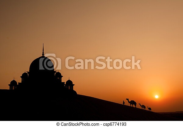 mosque in desert with camels silhouette - csp6774193