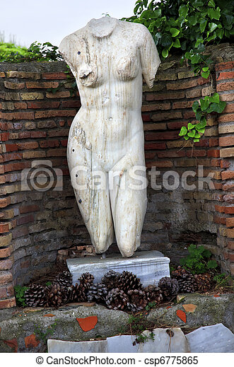 Ancient Roman Nude Woman Statue Ostia Antica Rome Italy - csp6775865