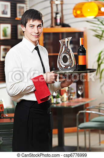 waiter in uniform at restaurant - csp6776999