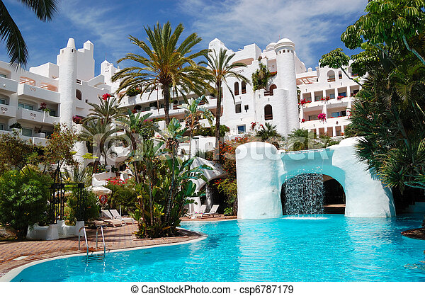 Swimming pool with waterfall and building of luxury hotel, Tenerife island, Spain - csp6787179